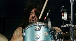 Grohl is back behind the kit with Queens