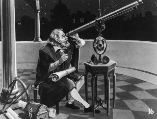 Galileo Galilei looks at the heavens through a telescope around 1620.