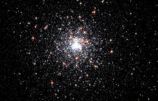 This view of globular cluster NGC 6624 was imaged by NASA's Hubble Space Telescope. The cluster is 27,000 light-years away and lies farther than the center of our galaxy in the constellation Sagittarius.