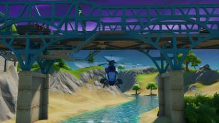 Fortnite Fly a Choppa under Purple, Red, and Blue Steel Bridge