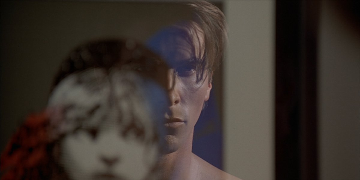 American Psycho Christian Bale as Patrick Bateman Les Mis reflection