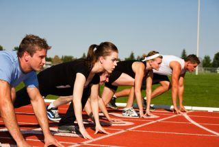Teens line up to begin a track race.
