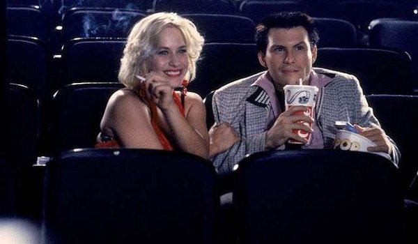 True Romance Patricia Arquette and Christian Slater enjoy a movie with some snacks