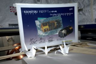 Three paper origami cranes were packed aboard the Japanese cargo ship Kounotouri 2 before being released to burn up in the Earth's atmosphere.