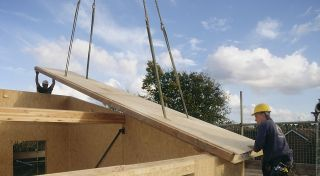 builders using structural insulated panels to build a house