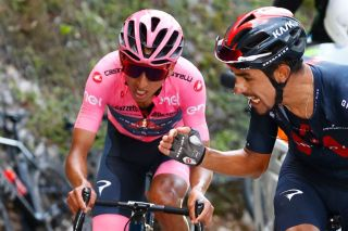 Team Ineos rider Colombias Daniel Martinez R encourages his teammate overall leader Team Ineos rider Colombias Egan Bernal as they ride in the last ascent during the 17th stage of the Giro dItalia 2021 cycling race 193km between Canazei and Sega di Ala on May 26 2021 Photo by Luca Bettini POOL AFP Photo by LUCA BETTINIPOOLAFP via Getty Images