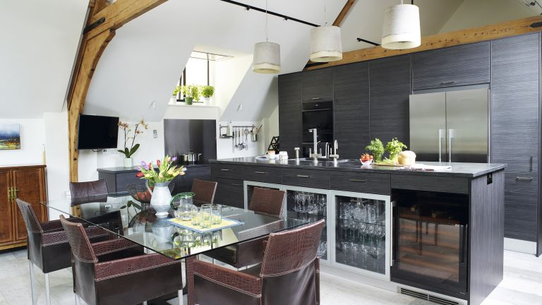 black kitchen in a converted chapel