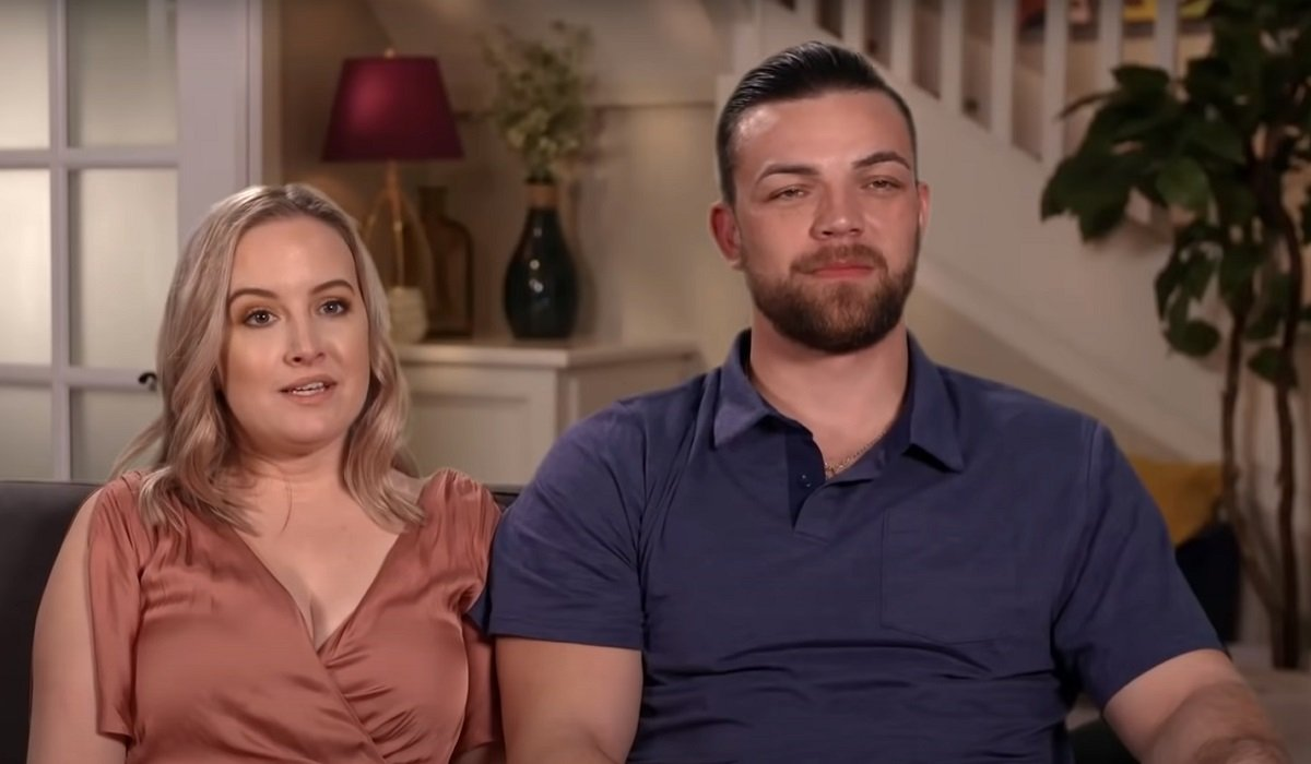 Elizabeth and Andrei sitting 90 Day Fiance: Happily Ever After? TLC