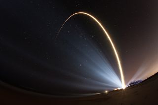 An Atlas V rocket carrying the U.S. Air Force's SBIRS Geo-3 missile warning satellite streaks into orbit from Cape Canaveral Air Force Station in Florida on Jan. 20, 2017 in this spectacular long-exposure view.