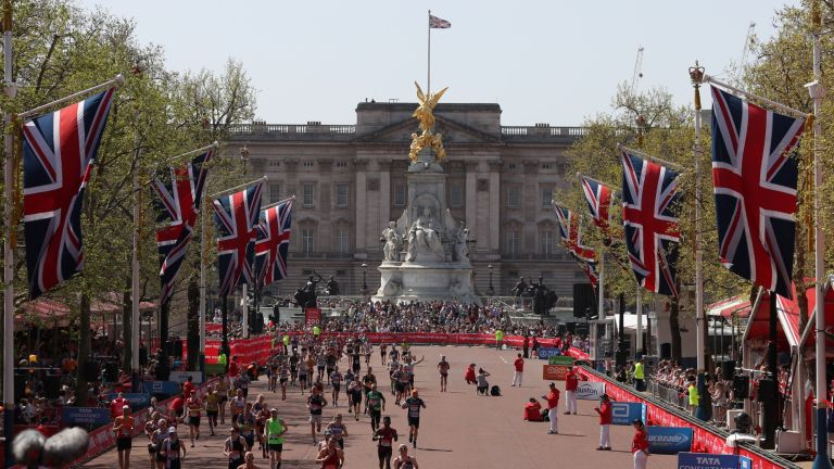 Participants run down The Mall during the 2018 London Marathon in central London