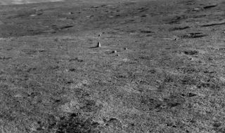 """This photo taken by China's Yutu 2 moon rover shows the elongated """"milestone"""" rock on the lunar surface."""