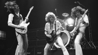 Status Quo's Francis Rossi, Rick Parfitt and Alan Lancaster live on stage in 1977
