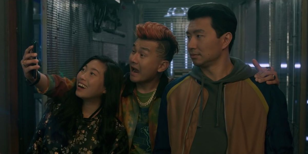 Shang-Chi, Katy and Jon Jon in the Marvel movie taking a selfie together