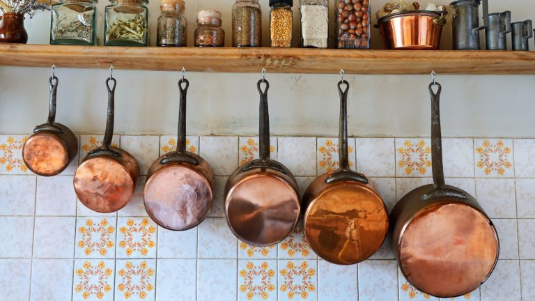 copper pans in a rustic kitchen