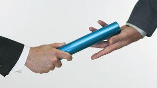 Businessmen handing a baton
