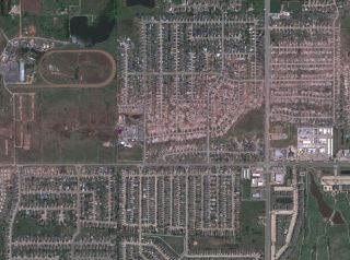 This satellite image taken on May 22 shows the exact path of the tornado as it tore through Moore, Okla.