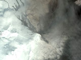 A satellite image from 2016 of Mount Pavlof's crater days before erupting.
