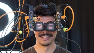 Researcher wearing prototype headset with eyes showing