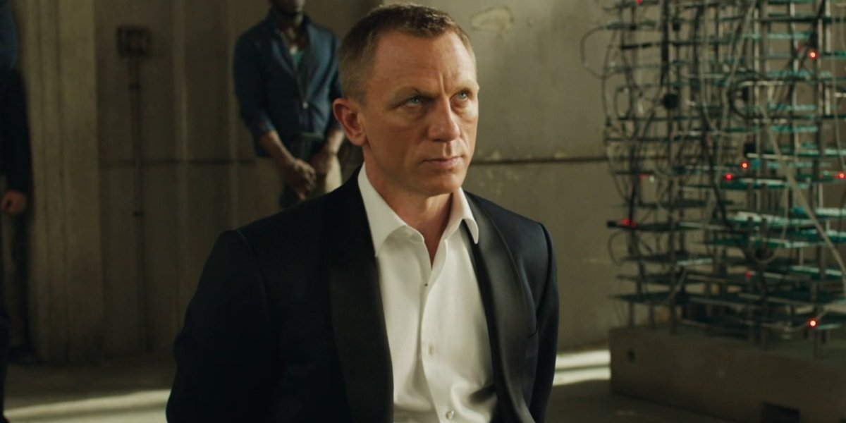 Daniel Craig looks annoyed while tied to a chair in Skyfall.