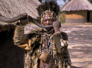 A witch doctor in Zimbabwe, in sub-Saharan Africa where belief in witchcraft is widespread.
