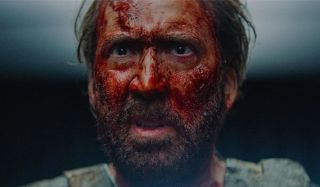 Mandy Nicolas Cage his confused face covered in blood