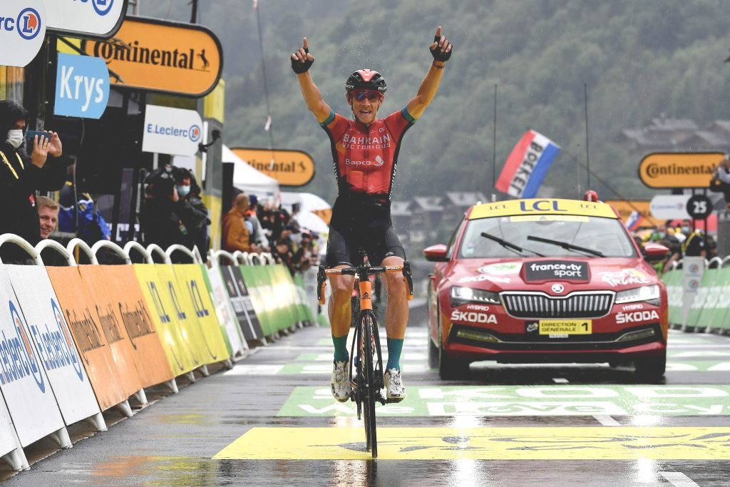 Team Bahrain's Dylan Teuns of Belgium celebrates as he crosses the finish line at the end 8th stage of the 108th edition of the Tour de France cycling race, 150 km between Oyonnax and Le Grand-Bornand, on July 03, 2021. (Photo by Philippe LOPEZ / AFP) (Photo by PHILIPPE LOPEZ/AFP via Getty Images)