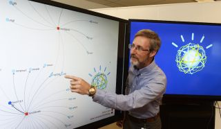 Researcher using Watson computer