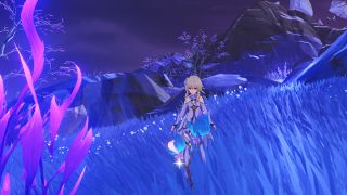 The traveler is standing near two Genshin Impact Amakumo Fruit surrounded by blue grass.