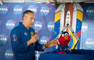 Elmo Speaks to Astronaut Mike Massimino