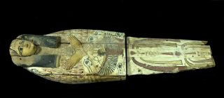 A wooden cover that would have held a mummy in ancient Egypt.