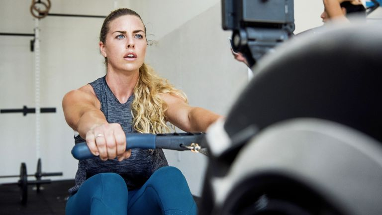 Woman doing a rowing for weight loss session