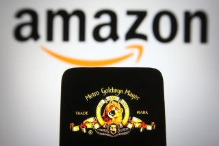 Metro-Goldwyn-Mayer (MGM) logo of US media company is seen on a smartphone screen with an Amazon logo in the background.
