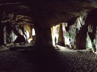 The twin entrance passages of the Sculptor's Cave led to a dread mortuary chamber where the ancient dead were left to rot.