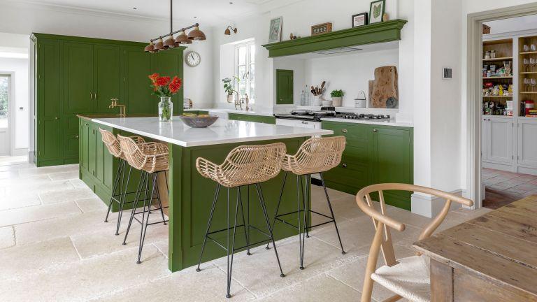 green kitchen Shaker cabinetry kitchen island rattan bar stools