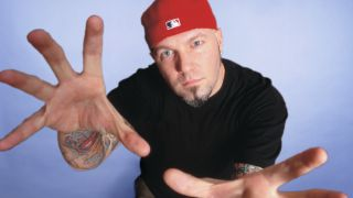 Limp Bizkit singer Fred Durst posing in his trademark red cap