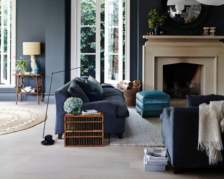 Living room fall decor with blue walls and stone fireplace