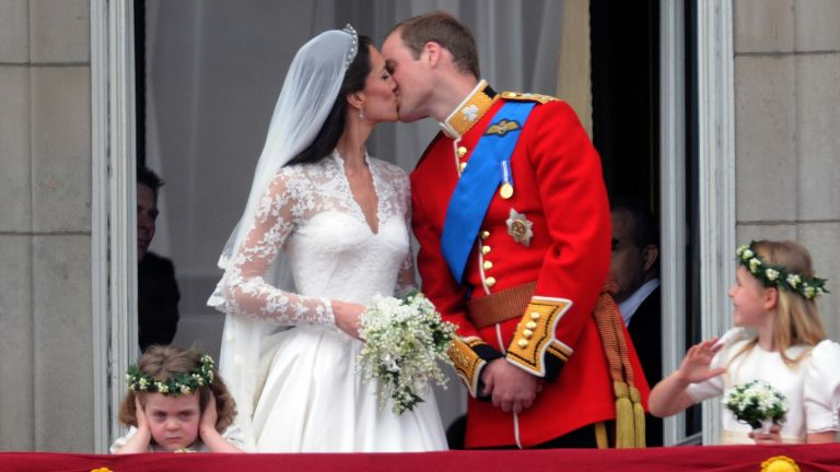 Prince William, Duke of Cambridge and Catherine Middleton, Duchess of Cambridge kiss on the balcony of Buckingham Palace following their wedding on April 29, 2011