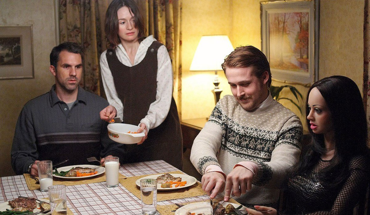 Lars and the Real Girl Ryan Gosling prepares his doll's food at the family table