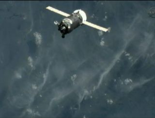 The unmanned Russian Progress 42 cargo ship is seen by a video camera on the exterior of the International Space Station just before docking on April 29, 2011.