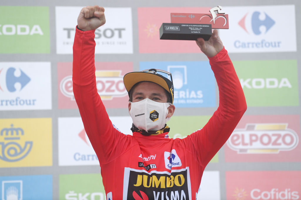 ALTU DEL GAMONITEIRU SPAIN SEPTEMBER 02 Primoz Roglic of Slovenia and Team Jumbo Visma celebrates winning the red leader jersey on the podium ceremony after the 76th Tour of Spain 2021 Stage 18 a 1626km stage from Salas to Altu dEl Gamoniteiru 1770m lavuelta LaVuelta21 on September 02 2021 in Altu dEl Gamoniteiru Spain Photo by Stuart FranklinGetty Images