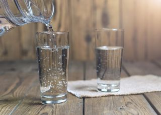 Two glasses filled with water.
