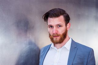 Why does this man have a red beard?