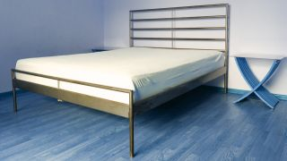 A white mattress with light yellow staining