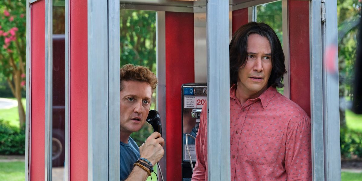Bill (Alex Winters) holds a telephone as he stands need to Ted (Keanu Reeves) in a booth in 'Bill and Ted Face the Music'