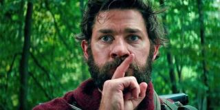 John Krasinski covers mouth with finger shhh A Quiet Place