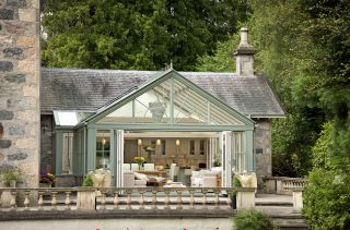 a large conservatory on a traditional home