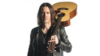 Alter Bridge's Myles Kennedy with a guitar over his shoulder