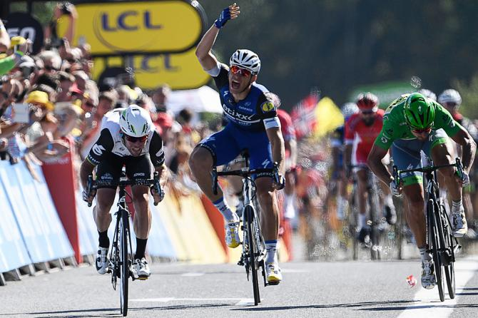 Marcel KIttel (Etixx-QuickStep) throws up his arms in complaint of Mark Cavendish's sprint