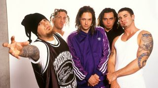 The band Korn in front of a white background