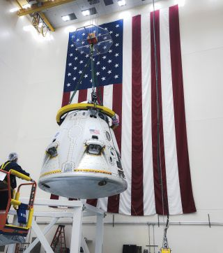 SpaceX Crew Dragon spacecraft inside a SpaceX processing facility at Cape Canaveral in Florida.